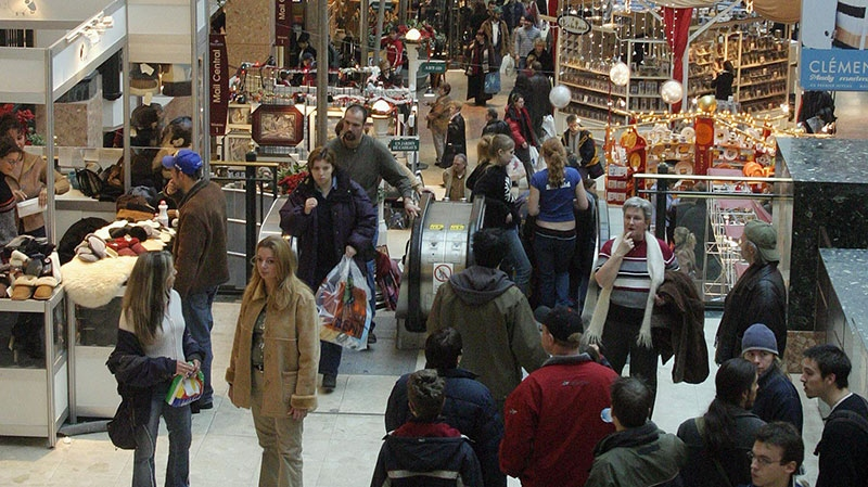 Customers shop in the Place Laurier shopping mall in Quebec City, Tuesday Dec. 23, 2003. According to VISA Canada, Dec. 23 is the busiest shopping day of the year. (Canadian Press / Jacques Boissinot)