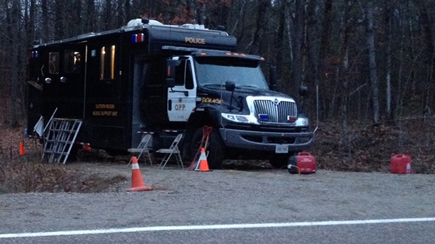 Ontario Provincial Police set up a command post as they investigate human remains found in a wooded area near Calabogie on Nov. 11, 2012.