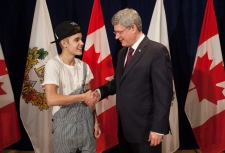 Stephen Harper presents Justin Bieber with medal