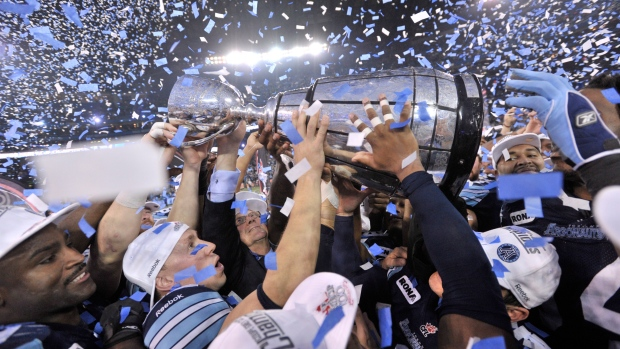 Toronto Argonauts players hold the Grey Cup
