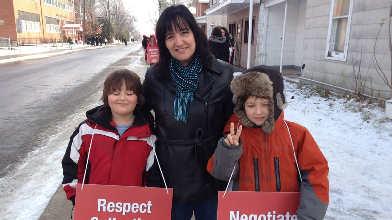 Arnprior Mom Peggy Leger on the picket line with kids Aidan and Rory Hogan from Walter Zadow Public School.