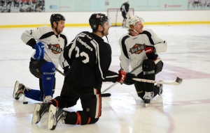 Boston Bruins' Chris Kelly, left, stretches with Ottawa Senators Chris Phillips, middle, and captain Daniel Alfredsson during a practice at the Bell Sensplex in Ottawa on Monday, January 7, 2013. THE CANADIAN PRESS/Sean Kilpatrick
