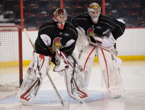 Ottawa Senators goalie Craig Anderson (left) stands in the goal crease with Ben Bishop during pre-season training camp in Ottawa, ON, Thursday, Jan. 17, 2013. THE CANADIAN PRESS/Adrian Wyld