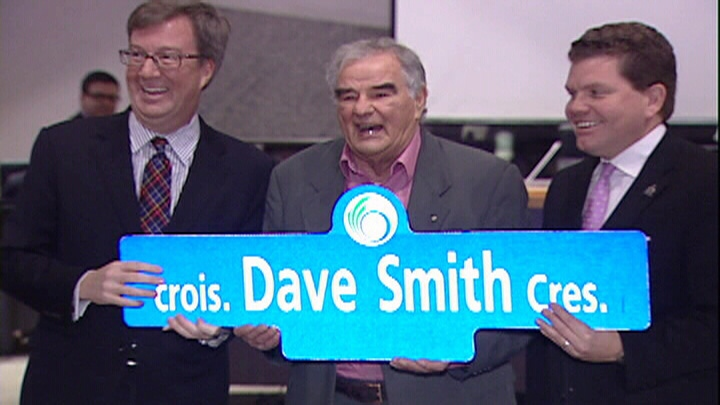 Ottawa Mayor Jim Watson (left) and Councillor Steve Desroches (right) honour philanthropist Dave Smith (centre) by naming a street after him in the community of Riverside South.