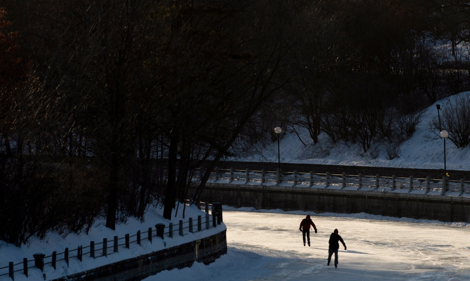 Two skaters make their way along the Rideau canal braving temperatures which felt like -40C with windchill in Ottawa, Wednesday January 23, 2013. THE CANADIAN PRESS/Adrian Wyld