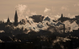 Winds blow vapour from buildings on the Ottawa skyline as temperatures hovered near -40C with windchill in Ottawa, Thursday, Jan. 24, 2013. THE CANADIAN PRESS/Adrian Wyld