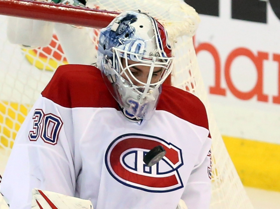 Montreal Canadiens goaltender Peter Budaj looks on as the puck bounces of his chest during second period NHL hockey against the Ottawa Senators in Ottawa on Wednesday, Jan.30, 2013. THE CANADIAN PRESS/Fred Chartrand