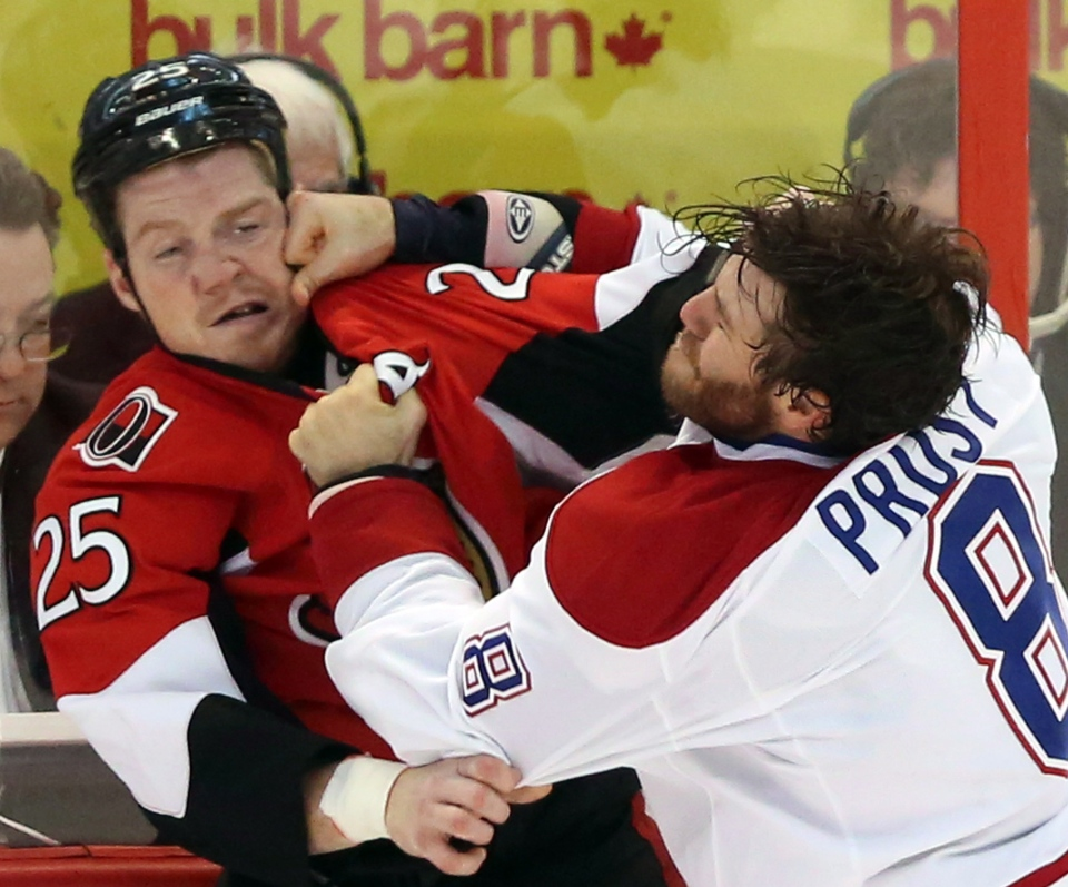 Montreal Canadiens' Brandon Proust (8)lands a punch on Ottawa Senators' Chris Neil (25) during first period NHL hockey action in Ottawa Wednesday January 30, 2013. THE CANADIAN PRESS/Fred Chartrand