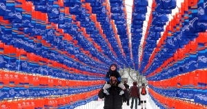 John Verheul and his son Xavier, 3, walk through a tunnel of 1,300 lanterns on display at Winterlude festival in Ottawa, Saturday February 2, 2013. The lantern garden is to commemorate the 50th anniversary diplomatic relations between Canada and South Korean. THE CANADIAN PRESS/Fred Chartrand