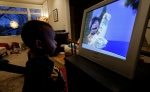 Joe Jensen, 2, watches television as a special treat in the afternoon at his home in Seattle on Feb. 12, 2013. (AP / Ted S. Warren)