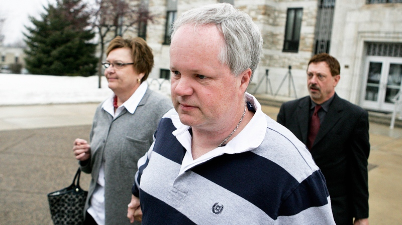 William Melchert-Dinkel, centre, leaves the Rice County Courthouse with his attorney Terry Watkins, right, and wife, Joyce Melchert-Dinkel, after waiving his right to a jury trial Thursday, Feb. 17, 2011.(AP / Robb Long)