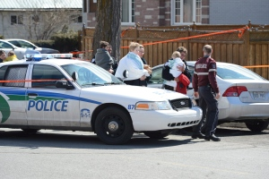 Police carry children to waiting parents and guardians in Gatineau on Friday April 5, 2013. THE CANADIAN PRESS/Sean Kilpatrick