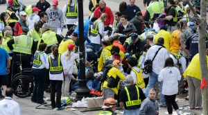 Medical workers aid injured people at the finish line of the 2013 Boston Marathon following an explosion in Boston, Monday, April 15, 2013. (AP / Charles Krupa)
