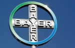 In this Sept. 25, 2008 file picture the logo of the Bayer AG chemical company rotates on top of an office building in Berlin, Germany. (AP Photo/Michael Sohn,file)