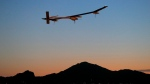 Solar Impulse, piloted by Andre Borschberg, takes flight during the second leg of the 2013 Across America mission from Sky Harbor International Airport in Phoenix at dawn on May 22, 2013. (AP / Matt York)
