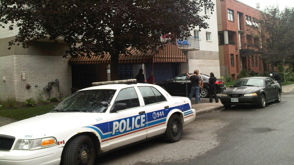 "An Ottawa police cruiser is captured at the scene of what police call a ""sudden death"" incident after a man in his early 30s fell from a balcony Tuesday, July 2, 2013."