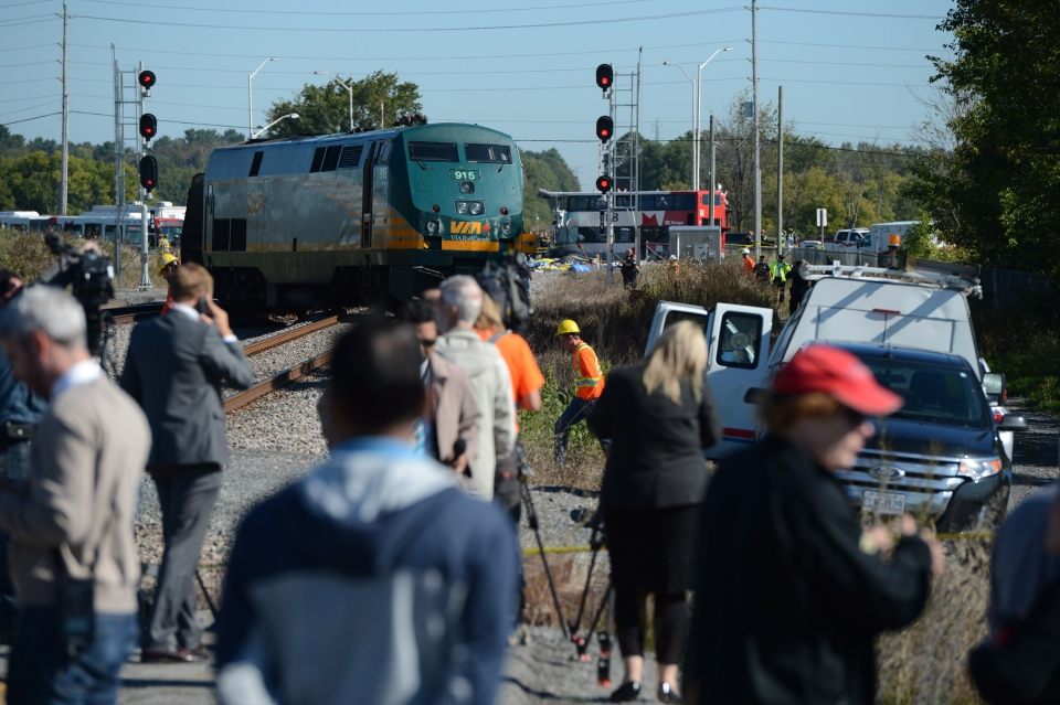 A Via Rail train and city bus are seen following a collision in Ottawa's west end Wednesday, Sept. 18, 2013. (Sean Kilpatrick/The Canadian Press)