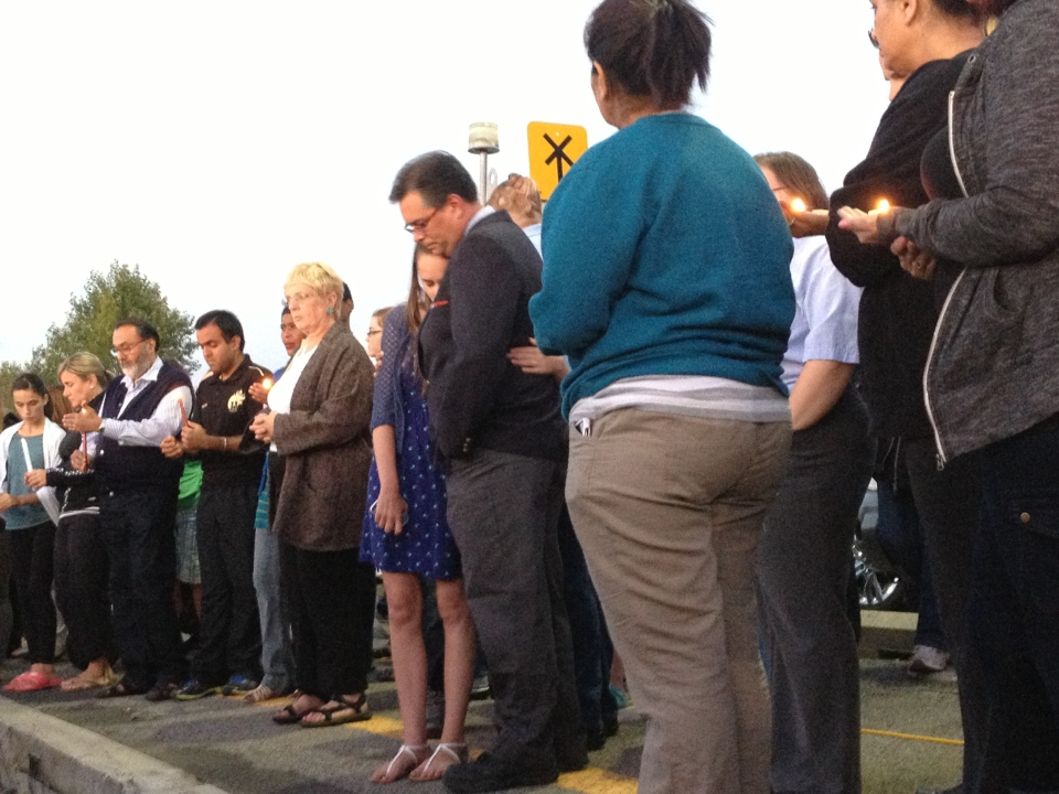 Dozens gather to light candles in memory of the dead and injured in Ottawa's worst bus accident on Sept. 18, 2013.