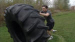 Ottawa MP Pierre Poilievre flips a 500 pound tractor tire as part of his intense workout