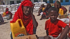 An old Somali woman displaced by drought, waits next to rations at a camp in Mogadishu, Somalia, Wednesday, July 20, 2011. (AP / Mohamed Sheikh Nor)