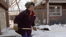 Annie Woo shovelling her own driveway.