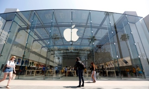People walk near the Apple store in Santa Monica, Calif. on Thursday, May 9, 2013. (AP / Reed Saxon)
