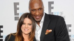 "This April 30, 2012 file photo shows TV personality Khloe Kardashian Odom and professional basketball player Lamar Odom from the show ""Keeping Up With The Kardashians."" (AP / Evan Agostini, File)"