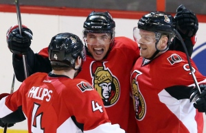 Ottawa Senators Cody Ceci (centre) celebrates his first NHL goal with teammates Chris Phillips (4) and Milan Michalek(9) in overtime NHL action to beat St Louis Blues 3-2, in Ottawa Monday, Dec. 16, 2013. Fred Chartrand/THE CANADIAN PRESS