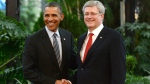 Prime Minister Stephen Harper shakes hands with U.S. President Barack Obama during the North American Leaders Summit in Toluca, Mexico, Feb. 19, 2014. Harper and Obama have made a hockey bet. (Sean Kilpatrick / THE CANADIAN PRESS)