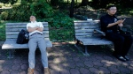 A man takes a nap on a bench at Tokyo's Hibiya Park during a lunch break Wednesday afternoon, Sept. 18, 2013. (AP / Shizuo Kambayashi)