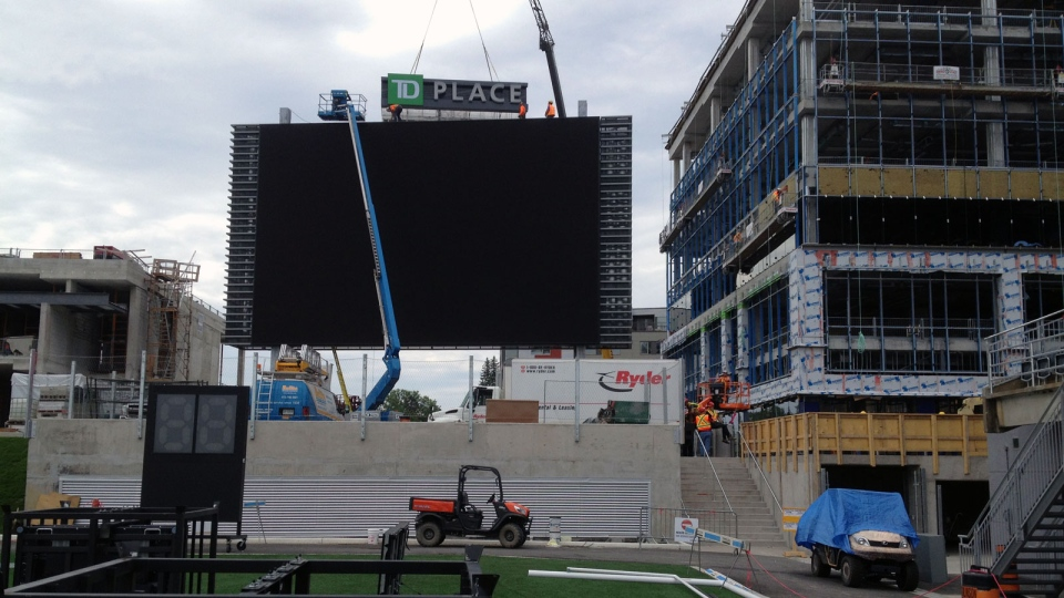 Construction crews install the scoreboard at TD Place in preparation of the Ottawa REDBLACKS' first home game on July 18. (Photo: Mark Dunlay/CTV Ottawa)