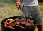 A man cooks food on a public barbecue in this file photo. (AP / Alex Brandon)