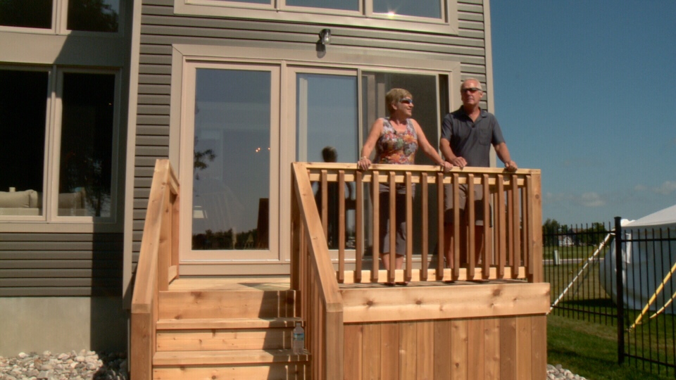 Retirees Rachel and Ralph Leroux enjoy the view at Kemptville's, Equinelle community, Aug. 11, 2014