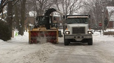 City plows clear excess snow in Ottawa on Tuesday Jan. 31, 2012.