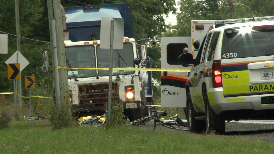 Emergency services attend the scene of a crash where say a 40-year-old woman is dead after being hit by a dump truck while riding her bike near River Road and Doyle Road in Manotick on Saturday, Sept. 6, 2014.