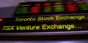 TMX Group tickers zoom across banners in Toronto on May 10, 2013. (Frank Gunn / THE CANADIAN PRESS)
