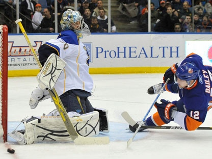 St. Louis Blues goalie Ben Bishop (30) blocks a shot on goal by New York Islanders' Josh Bailey (12) during the second period of an NHL hockey game Saturday, March 5, 2011, in Uniondale, N.Y. The Islanders won 5-2. (AP Photo/Kathy Kmonicek)