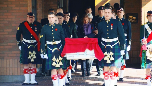 The Argyll and Sutherland Highlanders carry the casket of Cpl. Nathan Cirillo out of an Ottawa funeral home. The body making its way back to Hamilton along the Highway of Heroes.