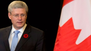 Prime Minister Stephen Harper makes his way to a news conference with Canadian media in Beijing, China, on Sunday, Nov. 9, 2014. (Adrian Wyld / THE CANADIAN PRESS)