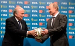 FIFA President Sepp Blatter and Russian President Vladimir Putin hold a soccer ball during the official ceremony of handover to Russia as the 2018 World Cup hosts, Sunday, July 13, 2014. (RIA-Novosti, Alexei Nikolsky, Presidential Press Service, )