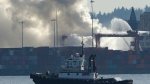 Smoke rises as a fire burns at the Port Metro Vancouver in Vancouver on Wednesday, March 4, 2015. (Jonathan Hayward / THE CANADIAN PRESS)