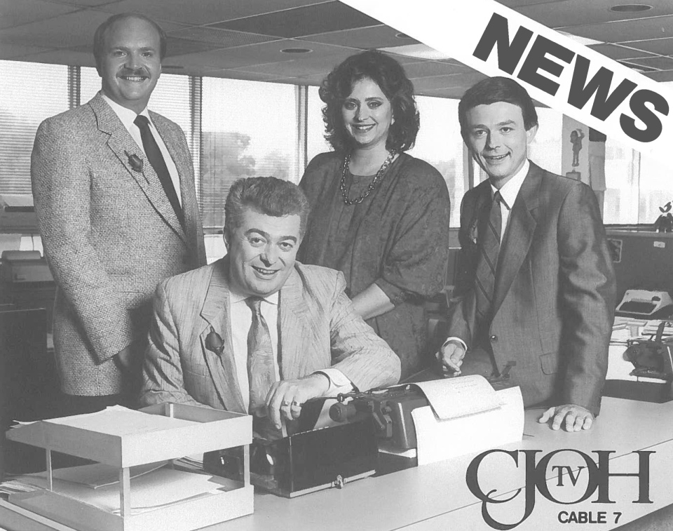 Max Keeping sits in the news room surrounded by CJOH news team members J.J Clarke, Leigh Chapple and Jim O'Connell in the late 1980's.