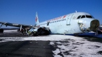 An Air Canada plane is shown after skidding off a runway as it landed early Sunday, March 29, 2015 in a snowstorm in Halifax, an airport official said, sending 23 people to hospital after passengers described the jet sliding on its belly before it came to a stop. THE CANADIAN PRESS/HO-Transportation Safety Board Canada