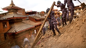Nepalese policemen clear the debris at Basantapur Durbar Square, damaged in Saturday&#39;s earthquake, in Kathmandu, Nepal, Sunday, April 26, 2015. <br> <br> A strong magnitude-7.9 earthquake shook Nepal&#39;s capital and the densely populated Kathmandu Valley before noon Saturday, causing extensive damage. (AP / Bernat Armangue)