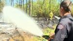 A firefighter puts out a blaze in Edmonton, Alta.