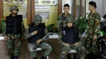 Thai soldiers guard at a building inside the compound of Government House Tuesday, April 21, 2009 in Bangkok, Thailand. (AP / Apichart Weerawong)