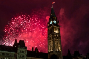 Fireworks explode behind the Peace Tower on Parliament Hill during Canada Day celebrations on Wednesday, July 1, 2015 in Ottawa.  (Justin Tang/THE CANADIAN PRESS)