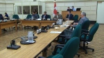 The NDP called a midsummer committee meeting to question the federal government's claim of a balanced budget.