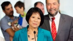 Olivia Chow, left, and NDP Leader Tom Mulcair hold a press conference in Toronto on Tuesday, July 28, 2015. (Darren Calabrese / THE CANADIAN PRESS)