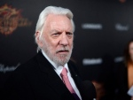Actor Donald Sutherland poses for photographers as he arrives for the Hunger Games: Mockingjay - Part 1 party at the 67th international film festival, Cannes, southern France, Saturday, May 17, 2014. (THE CANADIAN PRESS / AP/Photo by Arthur Mola/Invision/AP)